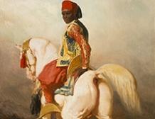 Groom Soudanais sur son étalon blanc