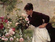 Jeune femme dans le jardin fleuri